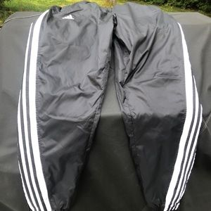 Men's small Adidas track pants with 4 stripes.